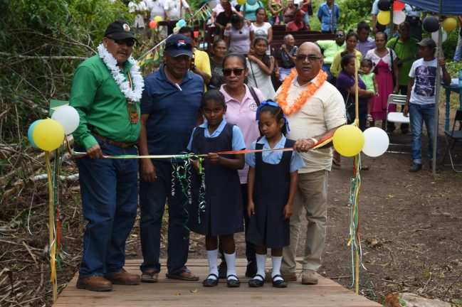 Minister of Indigenous Peoples' Affairs, Sydney Allicock and Regional Executive Officer (REO) Region 2, Dennis Jaikran during the ceremonial cutting of the ribbon to commission the Wakapoa bridge