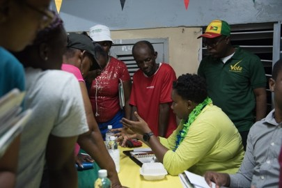 Minister within the Ministry of Communities, with responsibility for Housing, Annette Ferguson interacts with residents.