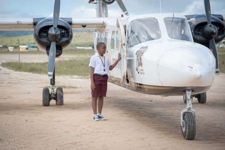 11-year-old Nevin McLean from Mahdia, who plans to be a pilot in the future, admires a Roraima Airways aircraft