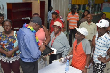 Minister of Public Infrastructure, Hon. David Patterson interacting with residents at the Somatta Point community engagement in Grove on the East Bank of Demerara.