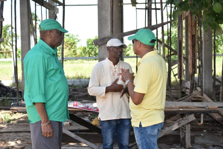 Minister of Business Haimraj Rajkumar and Director-General Joseph Harmon engaging with the NDC Chairman at the construction site for the new Neighbourhood Democratic Council building