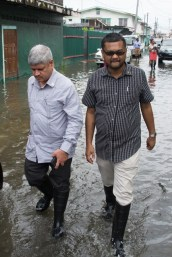 Minister within the Ministry of Public Infrastructure, Jaipaul Sharma and Mayor of Georgetown, Ubraj Narine visiting one of the flood-affected areas.
