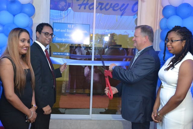 Chief Executive Officer (CEO) of Harvey Gulf International Marine, Shane Guidry, President of the American Chamber of Commerce of Guyana (AMCHAM), Zulfikar Ally and Petroleum Geologist at the Department of Energy, Marissa Foster during the ceremonial cutting of the ribbon to open Harvey Gulf International Marine's, Guyana Offshore Vessel Services Inc. in Kingston Georgetown.