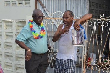Minister of Citizenship, Hon. Winston Felix interacting with residents of Bagotstown on Thursday.