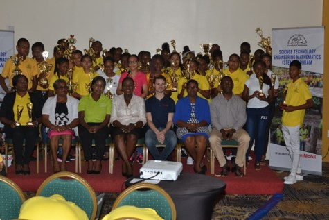 Minister of Education, Hon. Dr. Nicolette Henry with the prize winners and key stakeholders from ExxonMobil, GGMC, VYC Inc. and Headteachers of awarded schools.