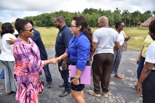 Dr. Joseph greeting the Minister of Public Health, Hon. Volda Lawrence before an engagement which took place recently