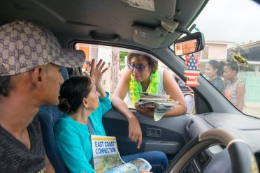 Minister of Public Telecommunications, Catherine Hughes engaging a resident