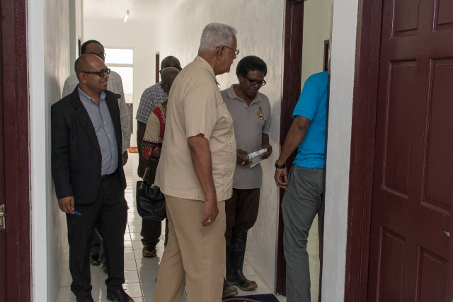 Minister of Agriculture, Noel Holder, is given a tour of the Facility by CEO of the NDIA, Fredrick Flatts.