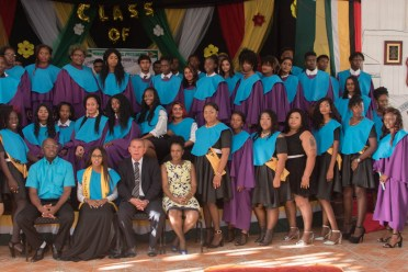 Minister of Social Cohesion, Hon. Dr. George Norton and other officials in a group picture with the 2019 YEST graduates.
