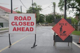 Road signs along Battery Road where the sewage pipe is being rerouted