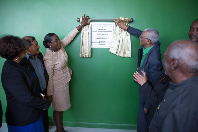 His Excellency, President David Granger unveiling the plaque to officially commission the Hinterland Student Dormitory in the presence of Minister of Indigenous Peoples' Affairs, Hon. Sydney Allicock, Minister within the Ministry of Indigenous Peoples' Affairs, Hon. Valerie Garrido-Lowe, Minister of Education, Hon. Dr. Nicolette Henry.