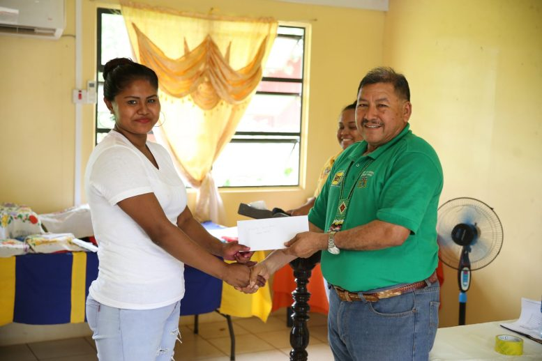 Emma Williams of Canal Bank receiving her grant from Minister of Indigenous Peoples' Affairs, Hon. Sydney Allicock