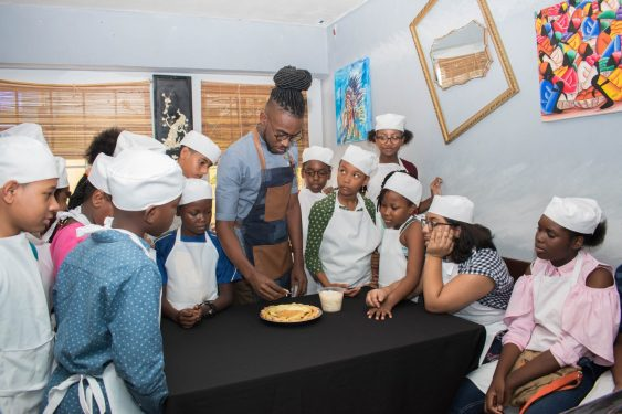 Chef Robinson instructing young students
