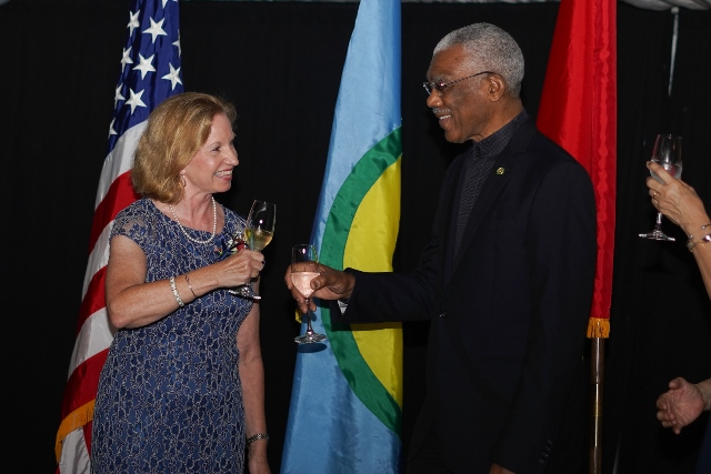 US Ambassador Sara-Ann Lynch and President David Granger share a toast for the US's 243rd Independence anniversary.
