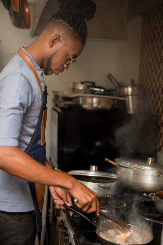 Kester Robinson preparing a meal