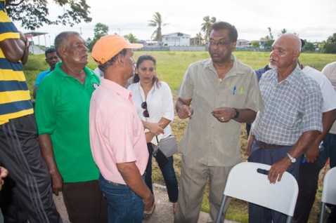 Minister of Public Security, Hon. Khemraj Ramjattan, interacting with residents of Crabwood Creek.