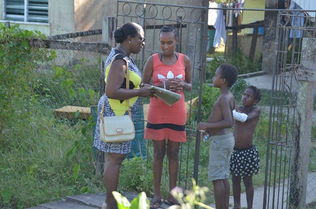 Minister of Education, Hon. Dr. Nicolette Henry interacts with residents in the community of Vergenoegen, during her walkabout exercise on Wednesday.