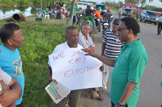 Attorney General (AG) and Minister of Legal Affairs, Hon. Basil Williams, SC., speaking to one of the protestors.