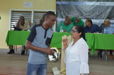Wife of the Prime Minister, Sita Nagamootoo gifted sport equipment to Denzel St Hill from the One Nation Youth Movement.