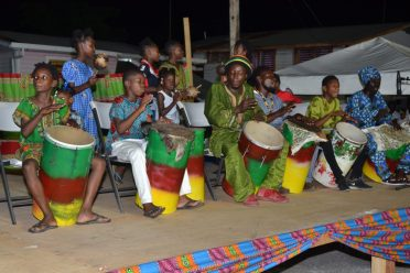 Drummers entertaining the gathering during the Emancipation-eve celebration at Buxton