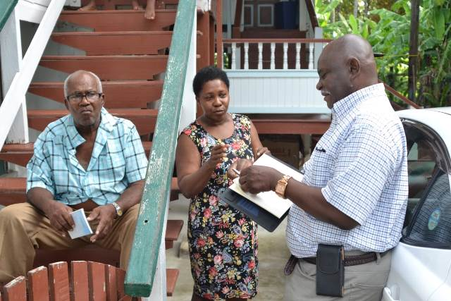 Minister of Citizenship, Hon. Winston Felix meeting with residents before the community meeting.