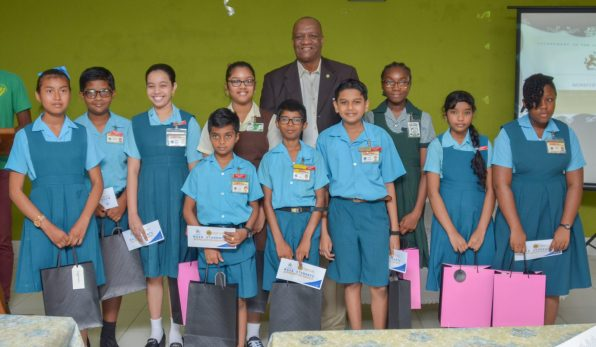 Top 10 Students of Region 3 along with Director-General within the Ministry of the Presidency, Joseph Harmon