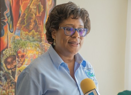 Ministry of Public Telecommunications, Minister Catherine Hughes.