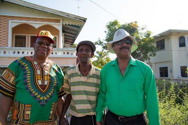 Minister of Finance, Hon. Winston Jordan and Minister of Legal Affairs, Hon. Basil Williams SC., with Litchfield Village's oldest resident 103-year-old James Lane.