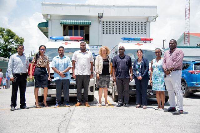 Members of the IDB team who are part of the acquisition team prior to the handing over of the ambulances.