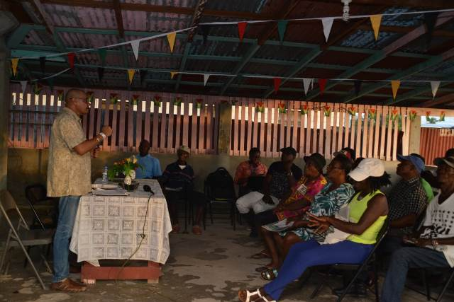 Minister of Business, Hon. Haimraj Rajkumar addressing the residents of Golden Fleece and Belladrum, West Coast of Berbice (WCB) during a community meeting.