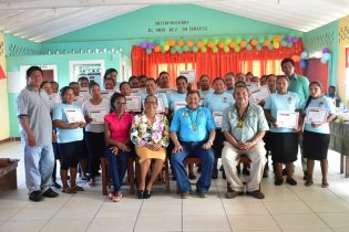Minister of Indigenous Peoples' Affairs, Hon. Sydney Allicock, Community Development Officer (CDO), Vincent Henry, Toshao of Nappi, Guy Fredericks, Senior Councillor of Parishara, Roy Andrew and the members of the Parishara Organic Food Processors group