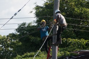 GPL workers on a utility pole in Burma.