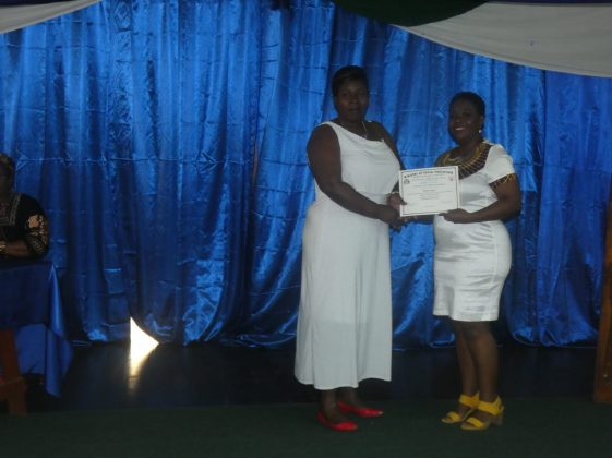 Mayor of Linden, Her Worship, Waneka Arrindell presents a certificate to one of the graduates