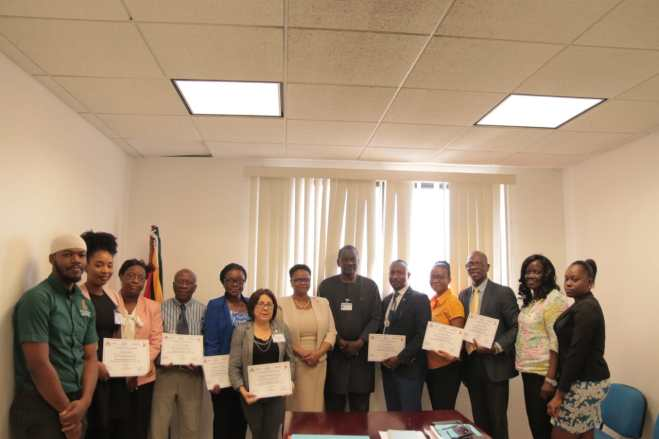 Minister of Public Health, Hon. Volda Lawrence and UNAIDS Country Director for Guyana and Suriname, Dr. Michael Gboun with participants of the HIV Clinical Management and Implementation of PrEP through a Public-Private Partnership Workshop