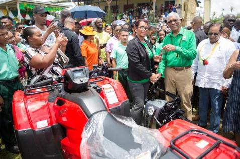President David Granger hand over the boat engine and the ATV to the community.