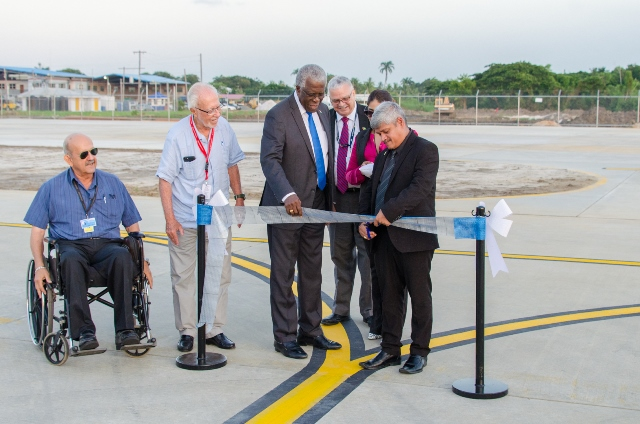 Minister within the Ministry of Public Infrastructure, Hon. Jaipaul Sharma and Director-General of the Guyana Civil Aviation Authority Col. Edbert Field, along with airport officials at Eugene F. Correia International Airport commissioning Taxiway Foxtrot.