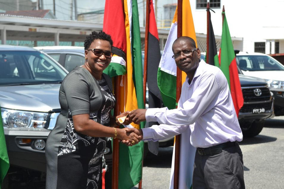 Regional Executive Officer of Region Seven, Cuyuni-Mazaruni Kerwin Ward receiving the key to the vehicle from Minister within the Ministry of Communities, Hon. Annette Ferguson