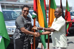 Regional Executive Officer of Region 1, Barima-Waini, Randolph Storm receiving the key to the vehicle from Minister within the Ministry of Communities, Hon. Annette Ferguson