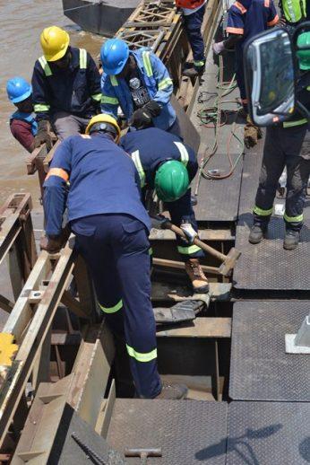 Workers at the Demerara Harbour Bridge.
