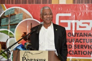 President David Granger delivers the feature address at the Guyana Manufacturing and Services Association's annual business luncheon.