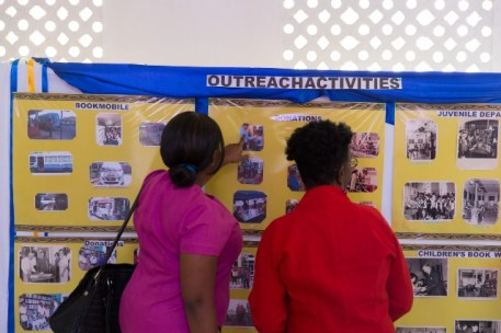 Persons viewing the pictorial exhibits at the Nation Library this morning.