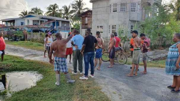 Residents in communities along the West Coast of Demerara in Region Three cleaning up following the overtopping of the seawall de to above normal high tides