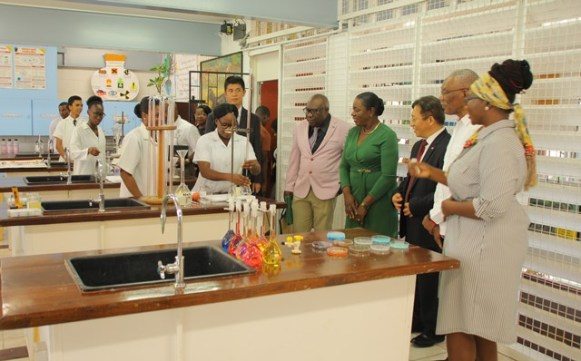 President David Granger, Minister Henry and Ambassador Cui Jianchun being given a tour of the science laboratories