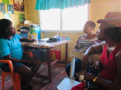 Medex Edghilo-Gill [left] meets with Minister of Public Health, Hon. Volda Lawrence and Director of Regional and Clinical Services, Dr. Kay Shako.