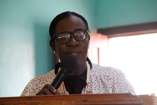 Minister Henry delivering her remarks