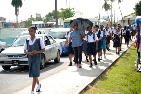 Students walking along Woolford Avenue to attend the first day of school.