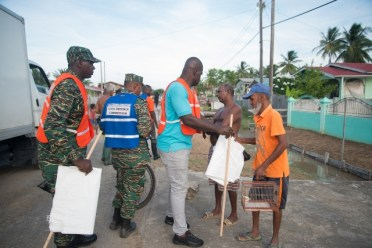 CDC and Region 3 officials handing out cleaning supplies to West Coast Demerara residents