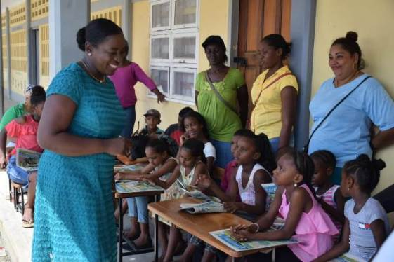 Education Minister, Hon. Dr. Nicolette Henry with parents and students of Rose Hall Primary.