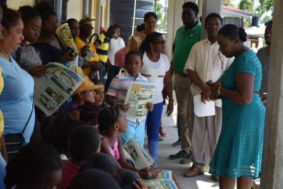 Minister of Education, Hon. Dr. Nicolette Henry engaging parents and students.