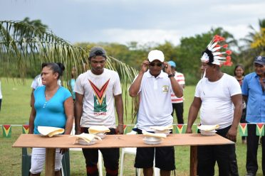 Participants about to participate in the Tuma pot eating competition